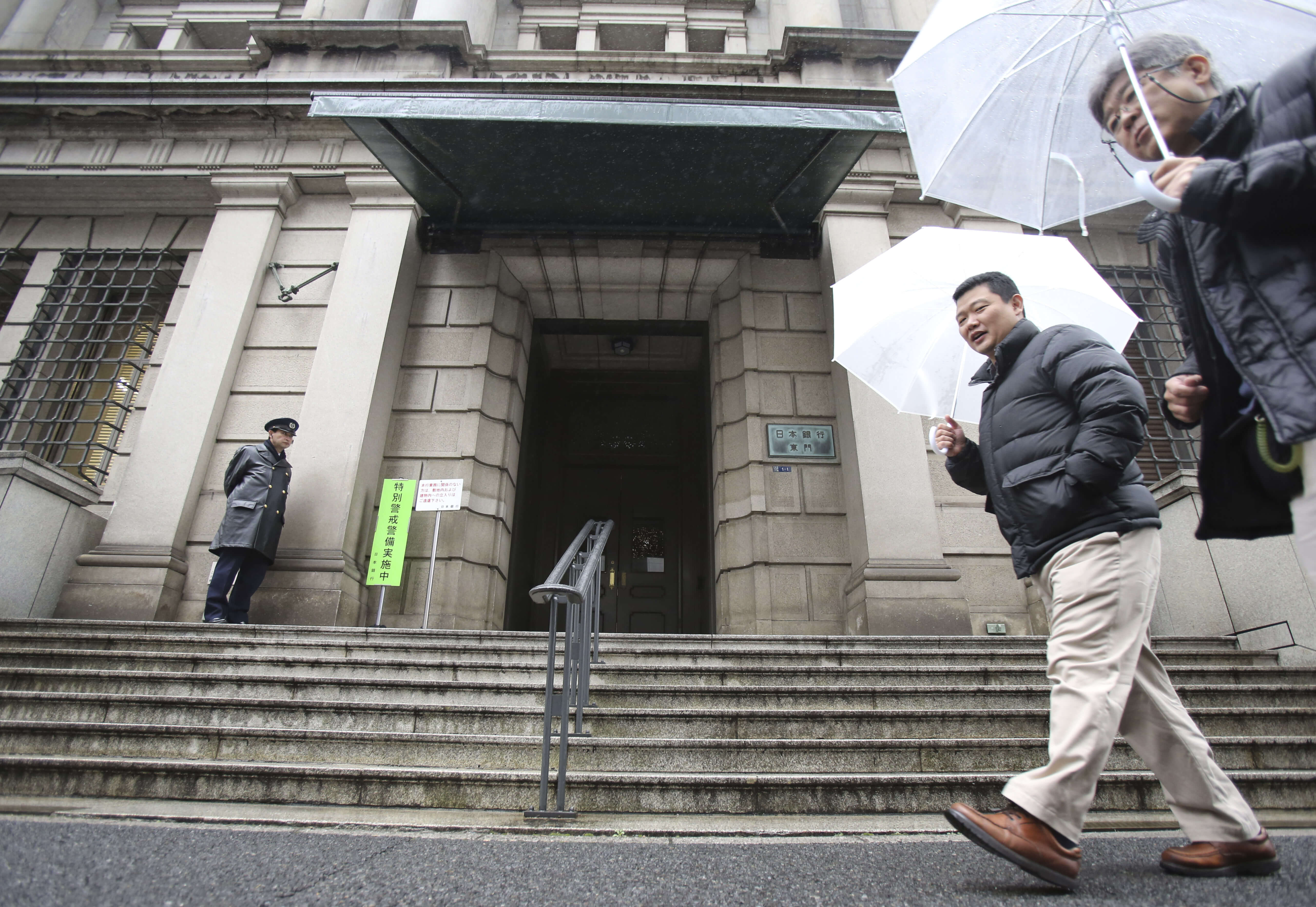 People walk past in front of Bank of Japan on Friday, Jan. 29, 2016. The Bank of Japan last Friday introduced a negative interest policy for the first time, and has signaled that it's prepared to push rates further negative.