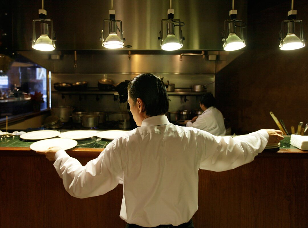 Workers prepare for lunch in a San Francisco restaurant kitchen.