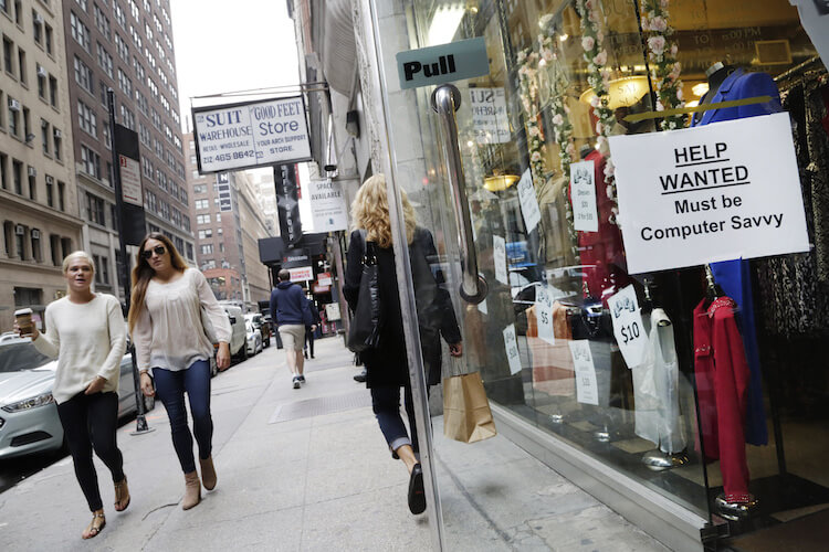 """A """"Help Wanted"""" sign hangs in a store window in New York. While the labor market is getting stronger, most measures indicate that labor market slack still remains."""