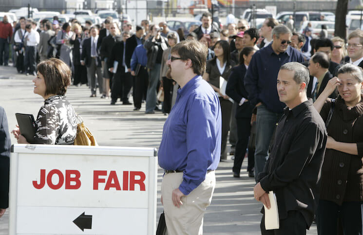Hundreds of people wait in line at a job fair in San Mateo, California, Wednesday, February 25, 2009.