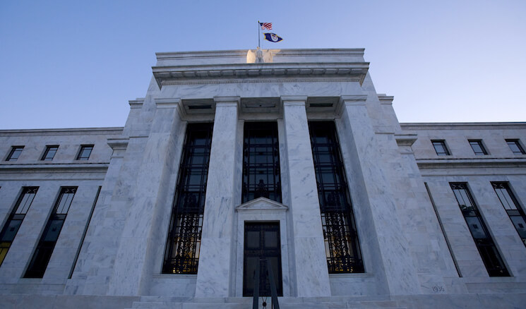 The headquarters of the Federal Reserve Bank is seen at sunrise in Washington.