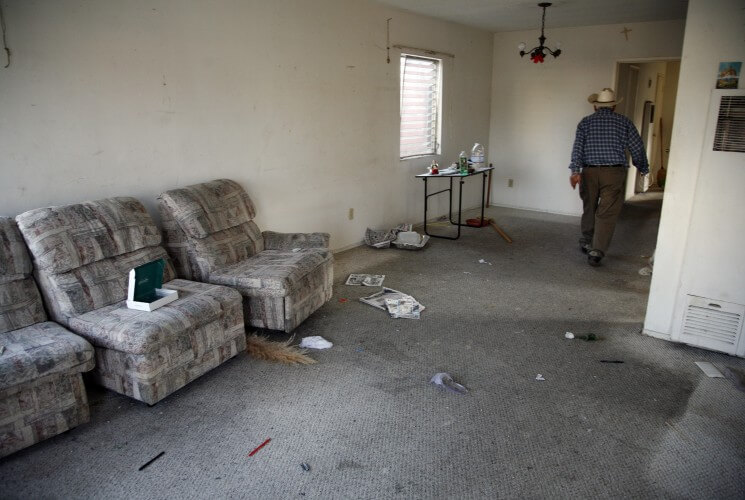 In this March 15, 2009 photo, a man walks through his empty living room as he vacates his home in Culver City, California after losing his property in foreclosure.