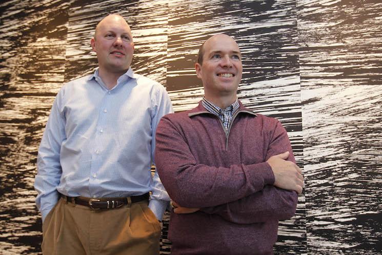 Marc Andreessen, left, and his longtime business partner, Ben Horowitz, pose in the office of their venture capital firm, Andreessen Horowitz, in Menlo Park, California.