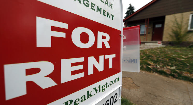 A rental sign is seen outside a property in Denver.