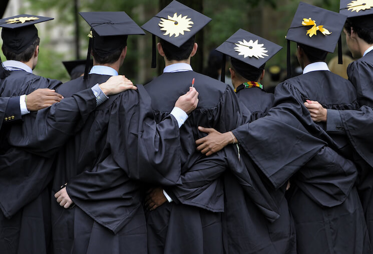 Graduates pose for photographs during commencement at Yale University in New Haven, Conn.
