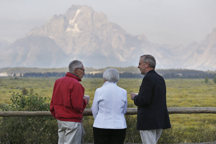 Federal Reserve Chair Janet Yellen, center, Stanley Fischer, left, vice chairman of the Board of Governors of the Federal Reserve System, and Bill Dudley, the president of the Federal Reserve Bank of New York, talk and view the Grand Tetons before Yellen's speech to the conference of central bankers from around the world, sponsored by the Federal Reserve Bank of Kansas City, at Jackson Lake Lodge in Grand Teton National Park, north of Jackson Hole, Wyo., Friday, Aug 26, 2016.