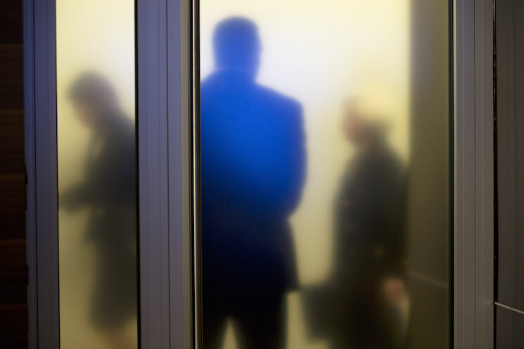 Federal Reserve Chair Janet Yellen, right, walks past a frosted glass door at the Federal Reserve.