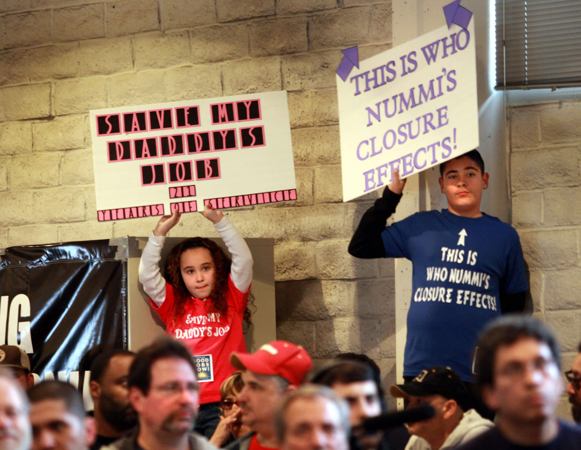 Marissa Perez and her brother Austin hold up signs for their father's job during a rally at the United Auto Workers Hall that hoped to persuade Toyota not to close its New United Motor Manufacturing Inc. automobile assembly plant, Friday, Feb. 12, 2010 in Fremont, Calif. (AP Photo/Dino Vournas)