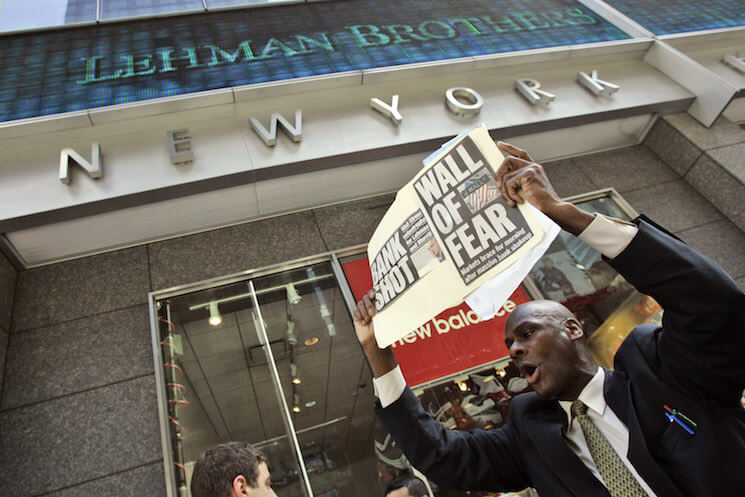 A man demonstrates outside the Lehman Brothers headquarters following the firm's 2008 collapse.