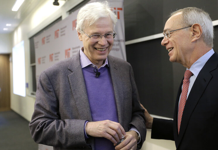 """Finnish Professor Bengt Holmstrom, of the Massachusetts Institute of Technology, left, smiles while speaking with MIT President L. Rafael Reif following a news conference, Monday, Oct. 10, 2016, on the campus of MIT in Cambridge, Mass. The Nobel Memorial Prize in economic sciences was awarded Monday to Oliver Hart and Holmstrom, who will share the prize. The Nobel jury praised the winners """"for their contributions to contract theory."""""""