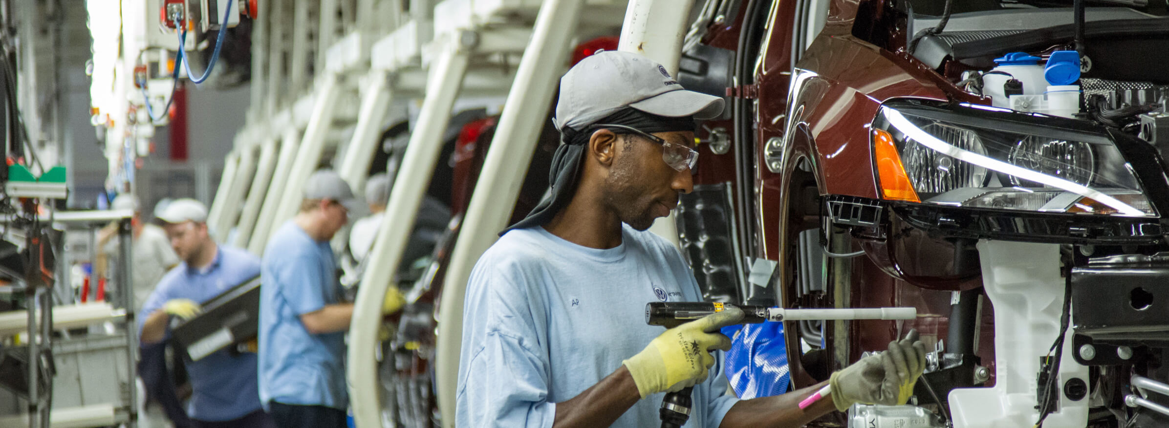 FILE - In this June 12, 2013, file photo, workers assemble Volkswagen Passat sedans at the German automaker's plant in Chattanooga, Tenn. AP Photo/ Erik Schelzig, file)