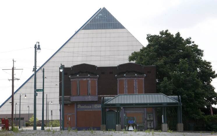 In this June 1, 2016 photo, vacant buildings stand near the Pyramid which houses a Bass Pro Shops megastore that opened in 2015, in Memphis, Tenn. Statistics describe an America that is nearly recovered from the Great Recession, but the national averages don't give a complete or accurate picture. Wealth is flowing disproportionately to the rich, skewing the data used to measure economic health.