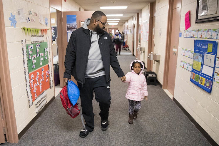 Eric Grant takes his three-year-old daughter Makayla to preschool in Philadelphia, Friday, Jan. 6, 2017.