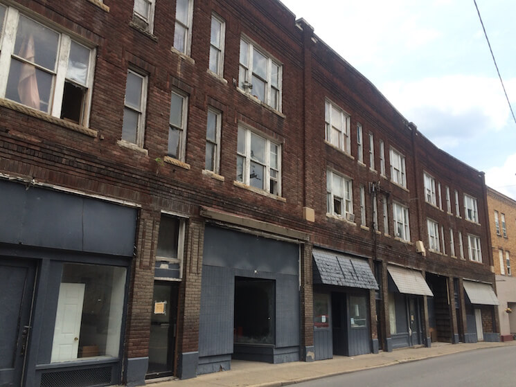 Shuttered storefronts in downtown Logan, W.Va.