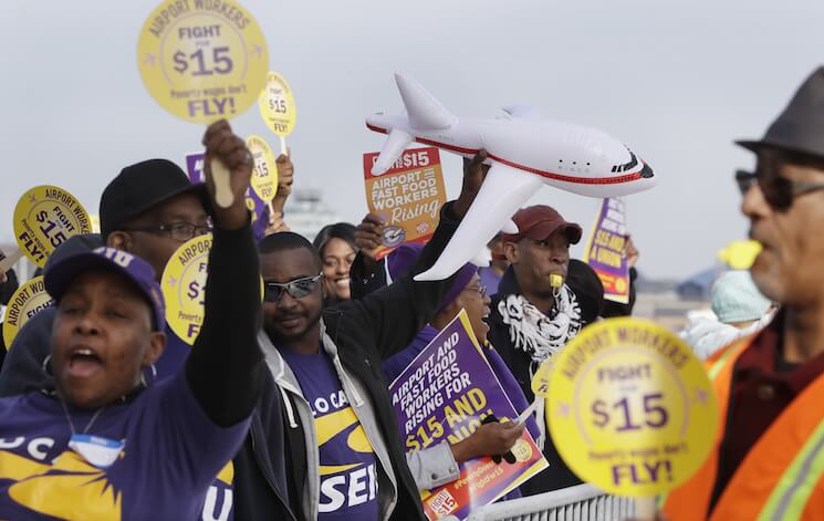 SEIU Local 1 union members protest for an increase in the minimum wage late last year at the Detroit Metropolitan Airport in Romulus, Mich.