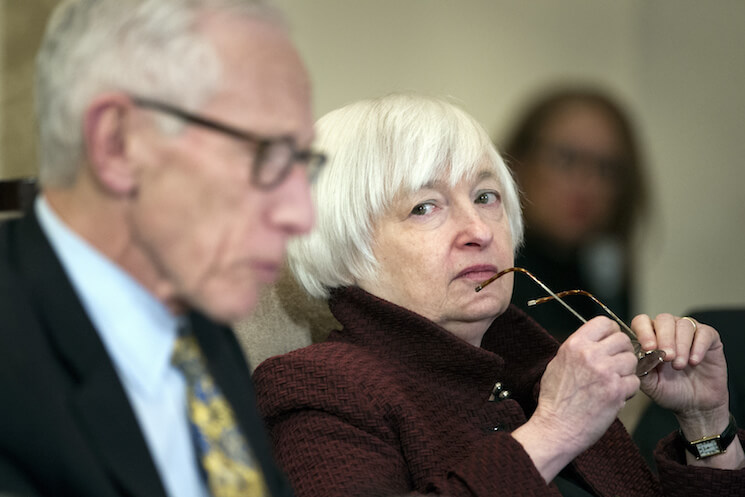 Federal Reserve Board Chair Janet Yellen listens as Vice Chair Stanley Fischer as he speaks during an open meeting in Washington last December.