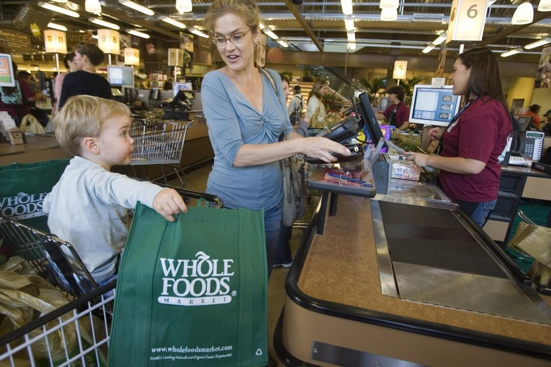 Customers shop for organic groceries at the Whole Foods Market Arroyo Parkway store in Pasadena, California.