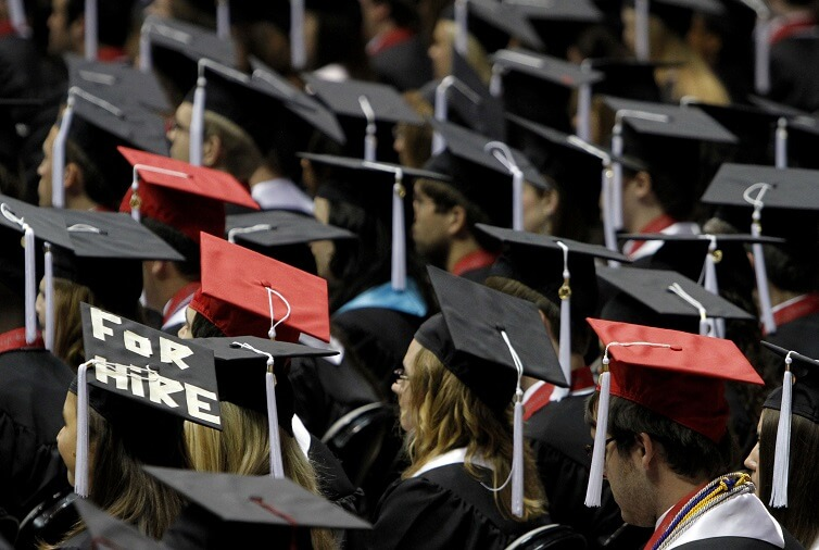 Students attend graduation ceremonies at the University of Alabama in Tuscaloosa, Ala.