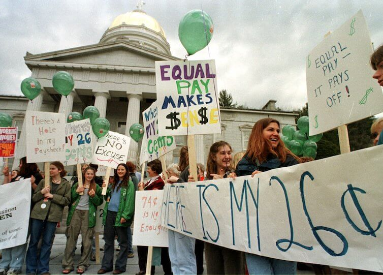 People gather for a rally on Equal Pay Day in Montpelier, Vermont.