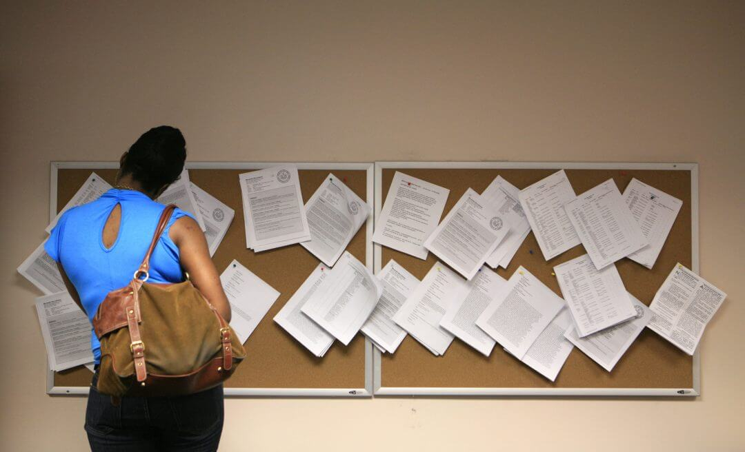A woman looks at job postings at the New York State Department of Labor, July 2009.