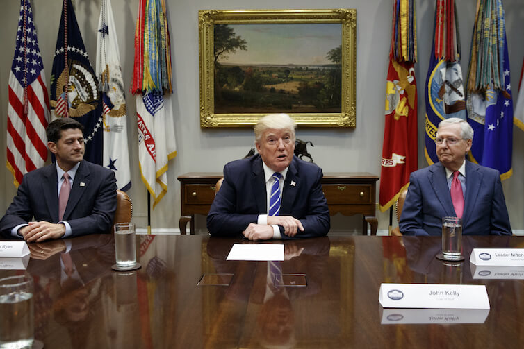 Speaker of the House Rep. Paul Ryan, R-Wis., left, and Senate Majority Leader Mitch McConnell, R-Ky., right, look on as President Donald Trump speaks during a meeting with Congressional leaders and administration officials on tax reform.