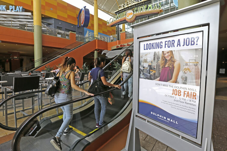 People head to a job fair at Dolphin Mall in Florida.