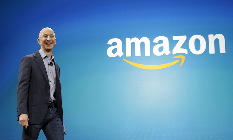 Amazon.com Inc. CEO Jeff Bezos walks onstage for the launch of the new Amazon Fire Phone in Seattle.