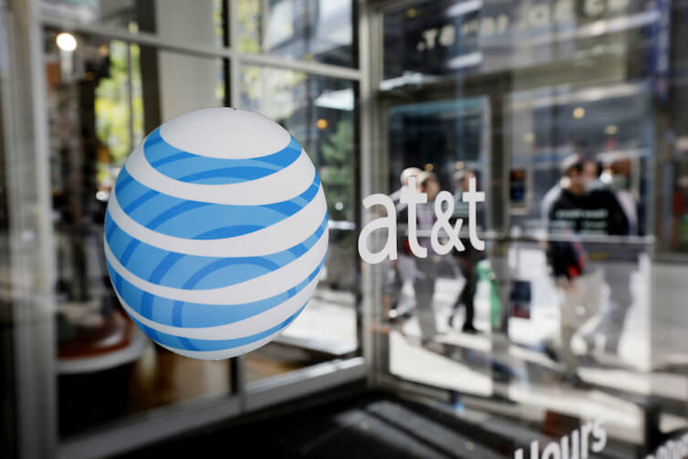 An AT&T Inc. logo on a retail store front in Philadelphia. The Department of Justice recently announced it was suing to block AT&T's acquisition of Time Warner Inc.<br />