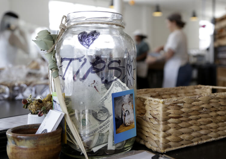 A tip jar sits on the counter at Zak the Baker in Miami.