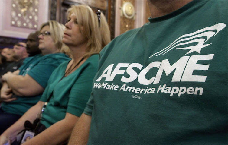 Members of the American Federation of State County and Municipal Employees union attend a forum in Springfield, IL. The recent U.S. Supreme Court decision in <em>Janus v. AFSCME</em> is predicted to decrease the size and budgets of public-sector unions, potentially limiting their effectiveness in collective bargaining for their members.