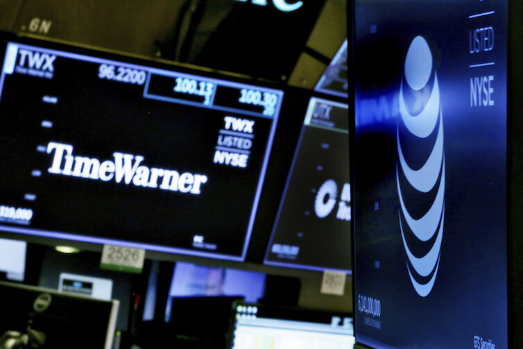The logos for Time Warner and AT&T appear on the floor of the New York Stock Exchange. Earlier this year, a federal judge approved the $85 billion mega-merger of the two companies, potentially ushering in a wave of media consolidation.