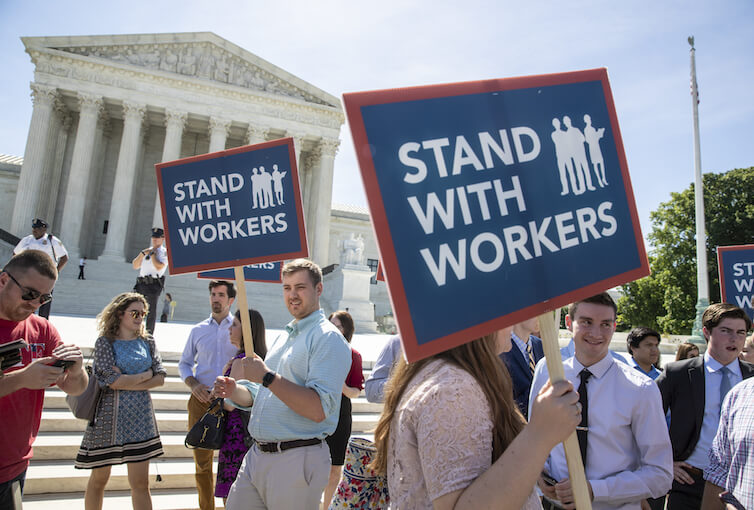 People gather at the Supreme Court awaiting a decision in an Illinois union dues case, <em>Janus vs. AFSCME</em>. Labor Day, this coming Monday, is a good time to reflect on the American labor movement and the impact of unions on workers.
