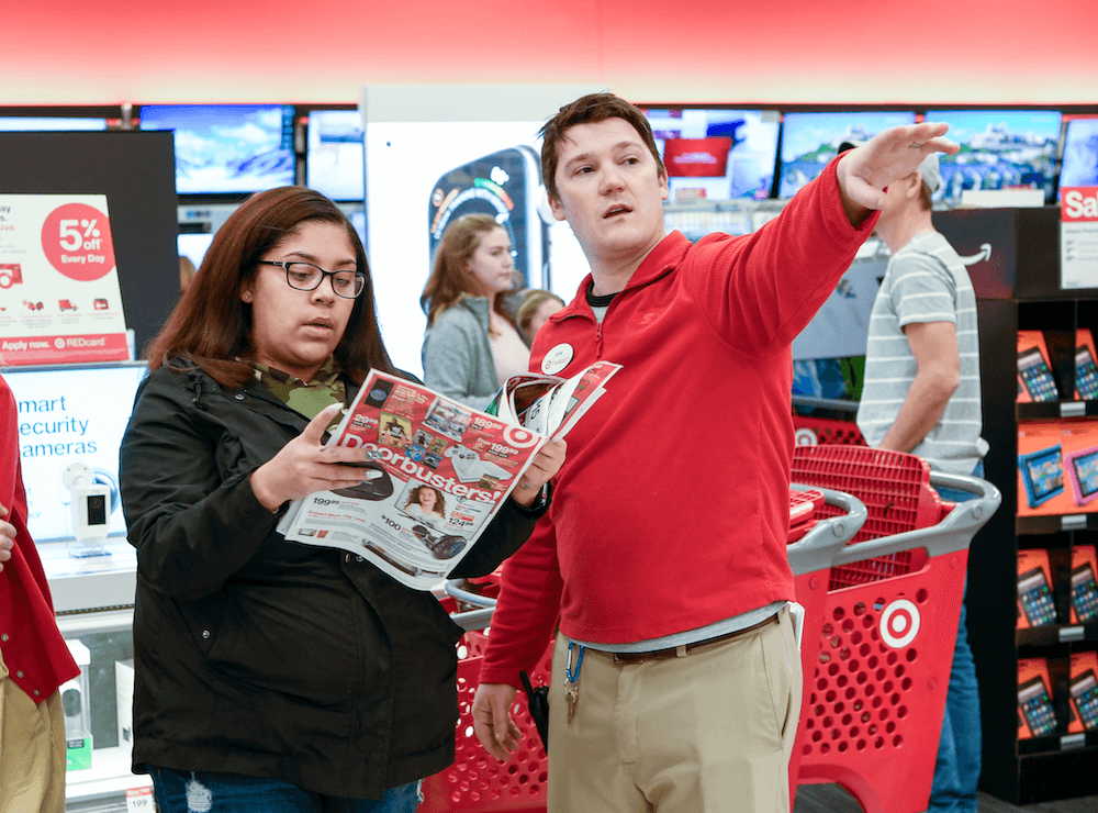 A Target employee helps a Black Friday shopper find top deals at Target on Thursday, Nov. 22, 2018 in Maple Grove, Minnesota.