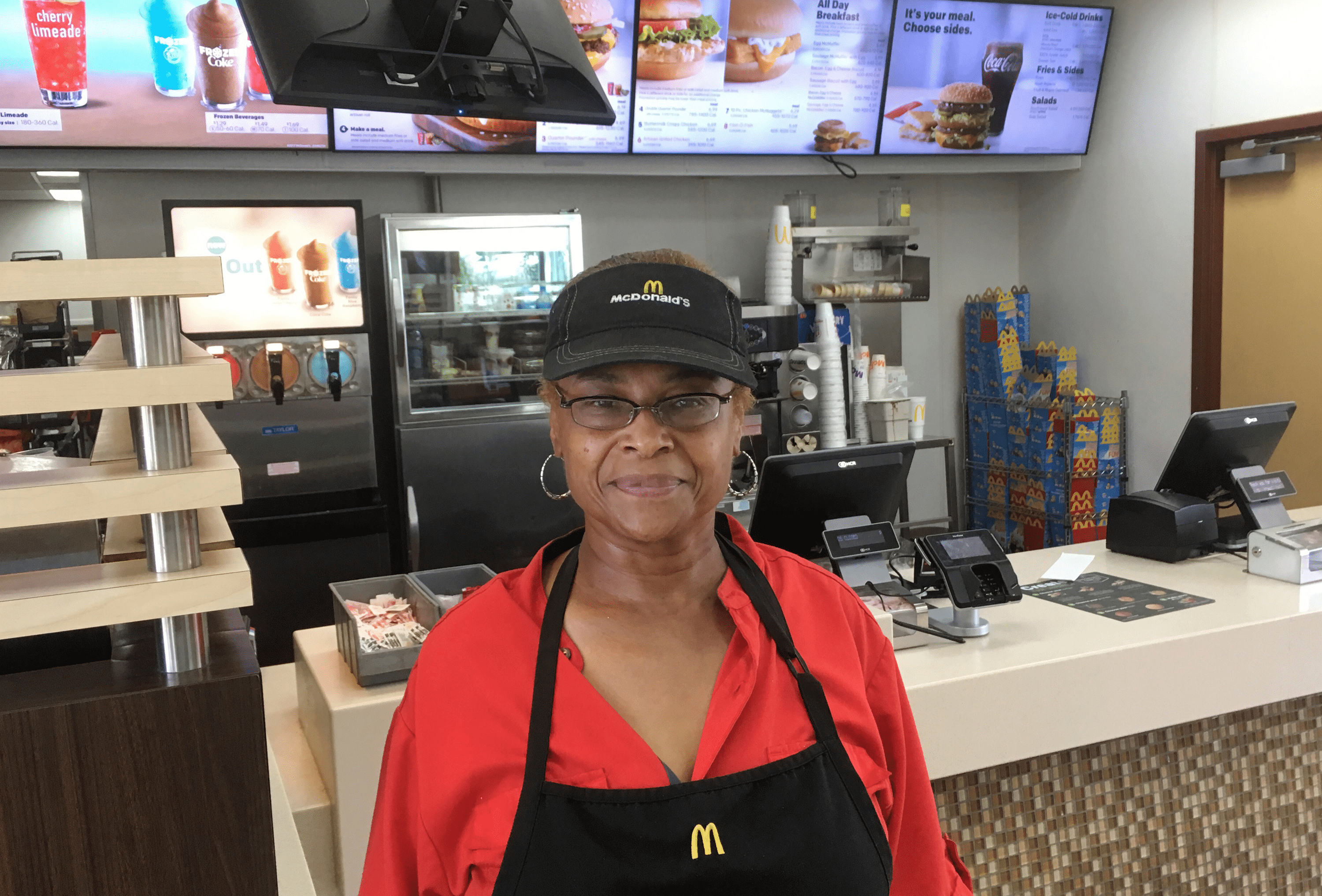 Bettie Douglas, a 59-year-old mother of three, stands inside the McDonald's she works in St. Louis.