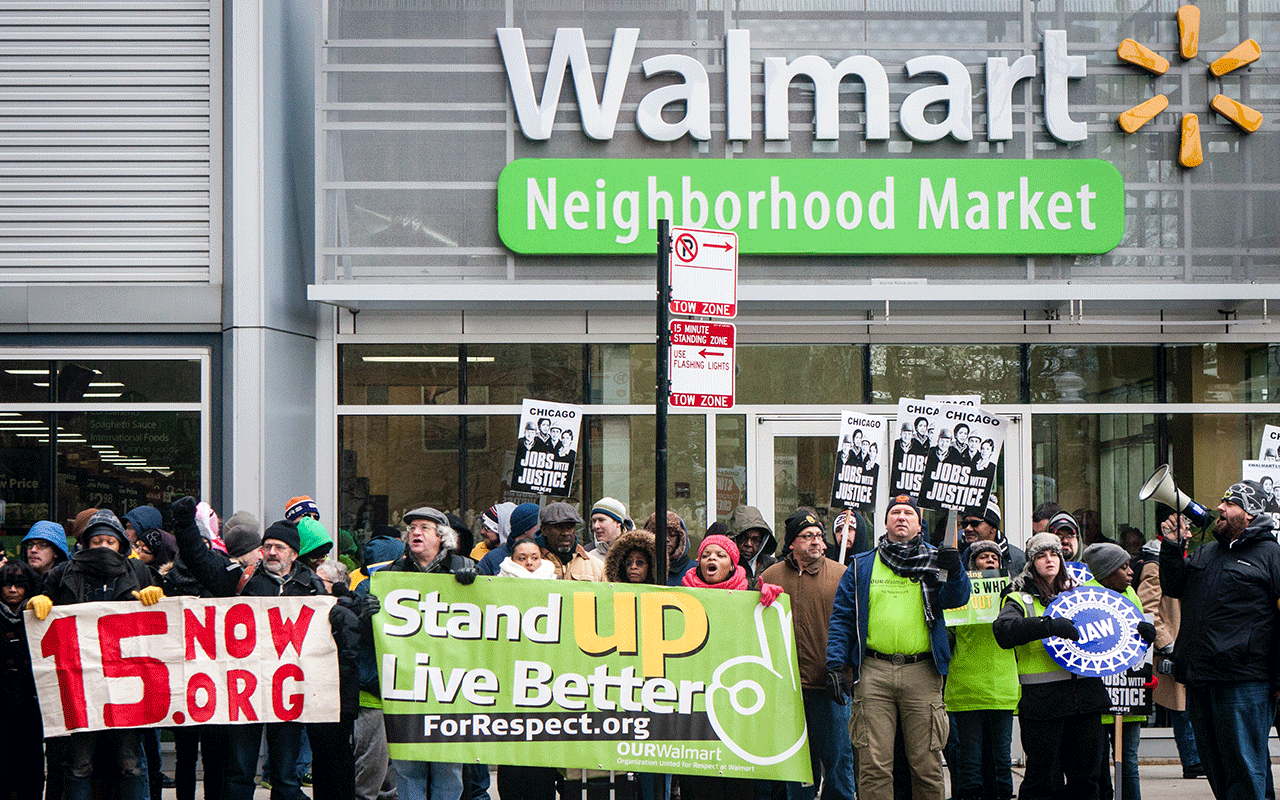 CHICAGO, ILLINOIS – NOVEMBER 28, 2014: Striking Walmart workers and supporters protest against low wages and charge that Walmart retaliates against employees who push for better working conditions.