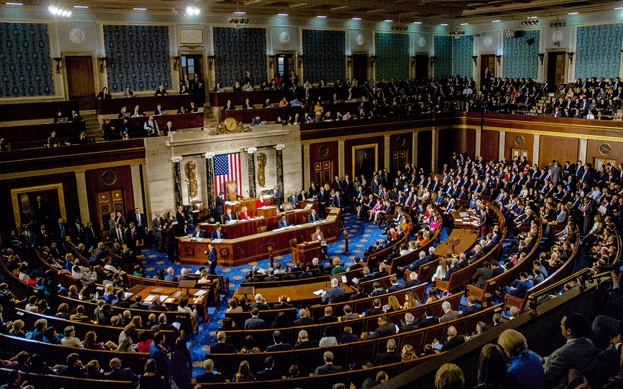 Washington, DC., USA, January 3, 2017 Members of the 115th Congress and their families mingle on the House floor.