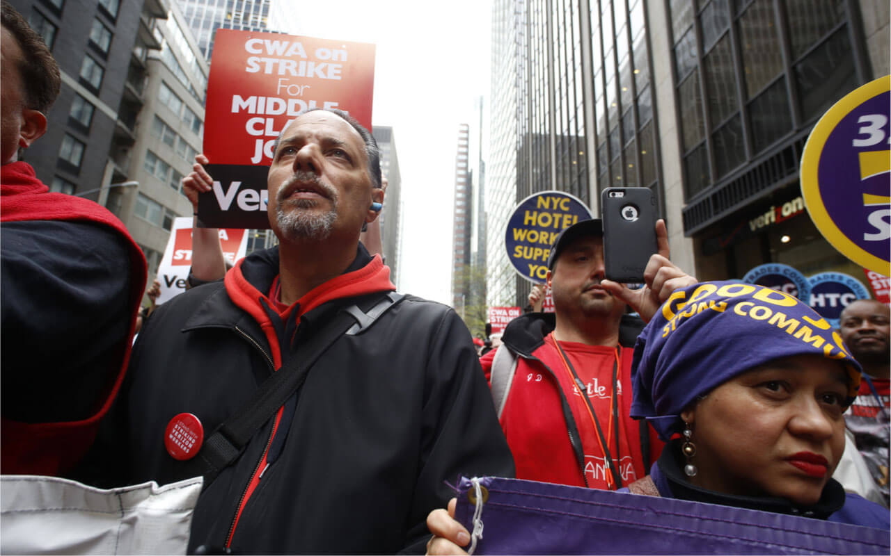 NEW YORK CITY – MAY 5 2016: Striking Verizon workers gathered with members of other unions and labor leaders in front of Verizon's Wall St headquarters.