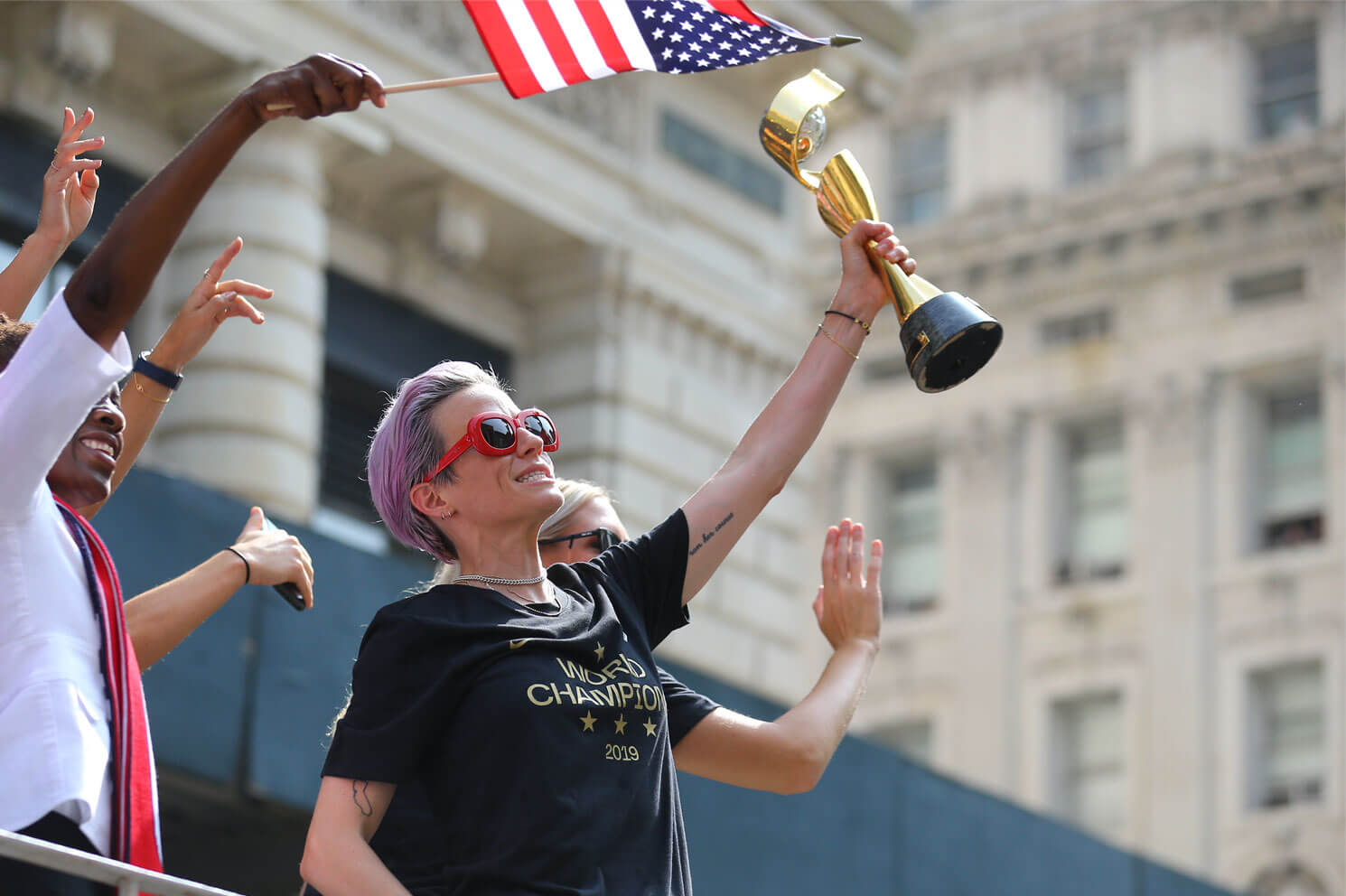 Megan Rapinoe holds the Women's World Cup trophy as the U.S. women's soccer team is celebrated with a parade along the Canyon of Heroes, Wednesday, July 10, 2019, in New York.