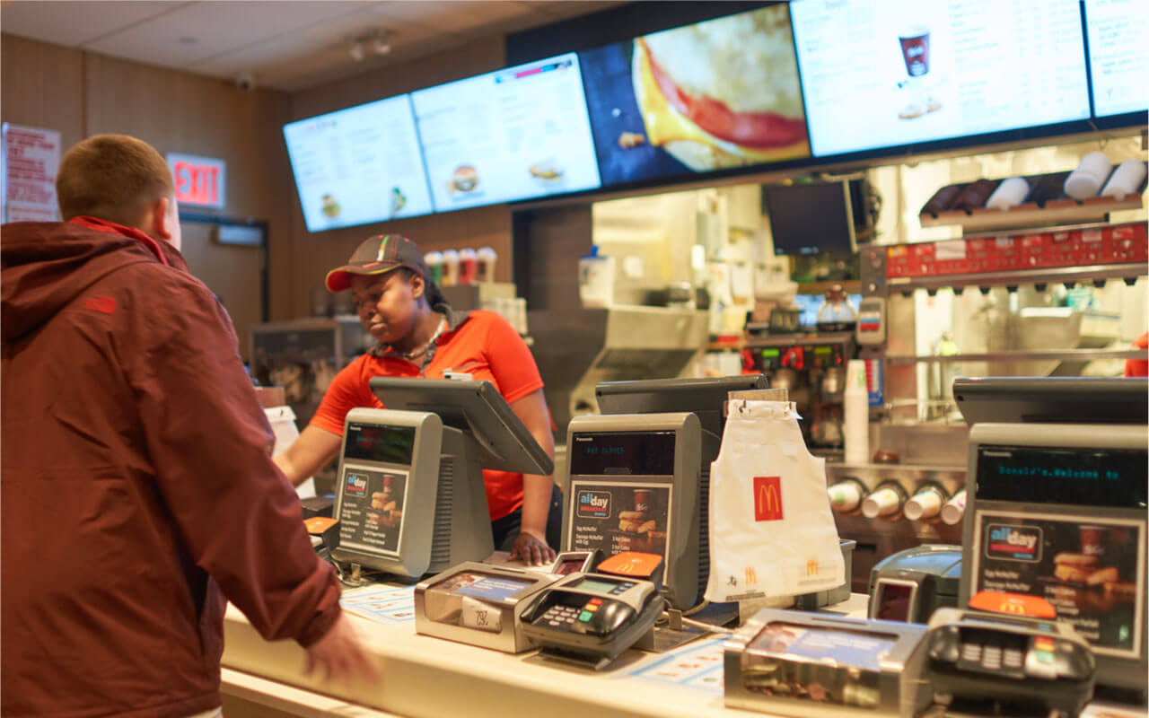 NEW YORK – CIRCA MARCH, 2016: An employee takes a customer's order at McDonald's—the world's largest chain of hamburger fast food restaurants.