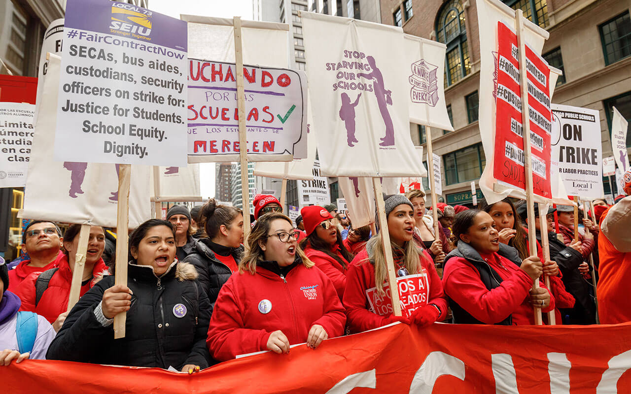 SEIU members and Chicago Teachers Union members protest during a rally and march on the first day of a teacher strike, Oct. 17, 2019, Chicago, IL.