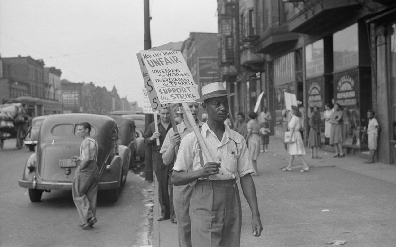 Striking workers picketing a reality company in New York City, ca. 1936-42.