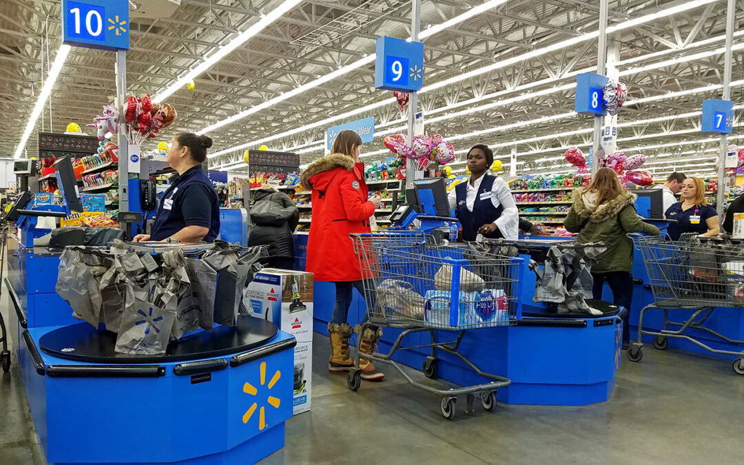 Cashiers heading the registers at a Walmart in Saugus, Mass., February 2018.