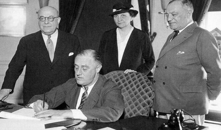 Franklin Roosevelt signs the Wagner-Peyser Bill creating the US Employment Service, June 6, 1933.